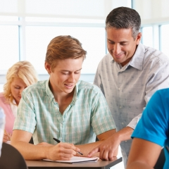 https://www.dreamstime.com/stock-image-tutor-helping-student-class-image21042461#res3189100